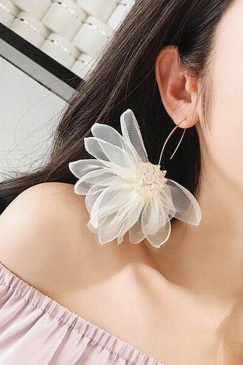 big trendy earrings