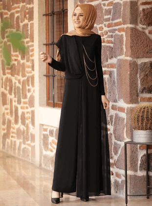 black jumpsuit with brown hijab